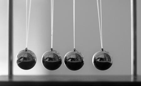 Newtons-Cradle_-Evonne-(Flickr-credit)-500px